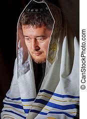 Ultra Orthodox Jewish man praying in the morning.