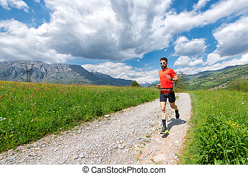 Ultra trail runner athlete prepares on a dirt road