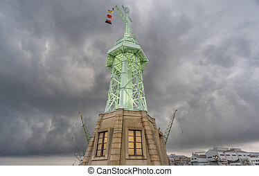 Ultra wide view of lighthouse in Kobe, stormy clouds Japan