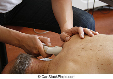 Ultrasound physiotherapy - Physiotherapist treatment on...
