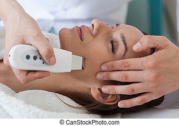 Ultrasound skin cleaning - Close-up of a woman getting...