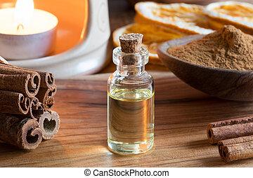 um, garrafa, de, canela, óleo essencial, com, canela