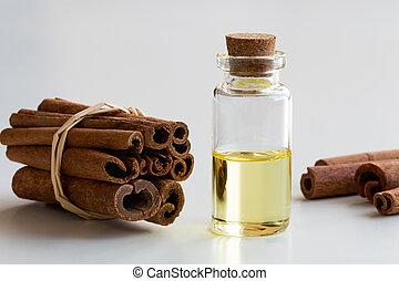 um, garrafa, de, canela, óleo essencial, com, canela, branco, fundo