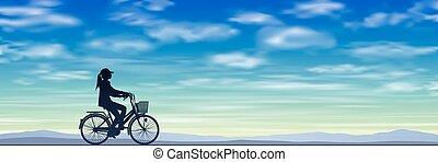 um, menina numa bicicleta