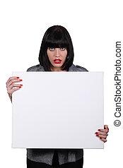 um, mulher olha, espantado, e, mostrando, um, branca, painel