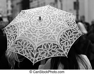 umbrella all hand-decorated with lace doilies and two women