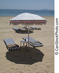 Umbrella and beds on the beach