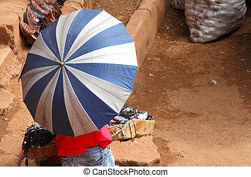 Umbrella Covered African Market Vendor - A market vendor ...