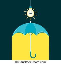 Umbrella in a dark room under the light bulb