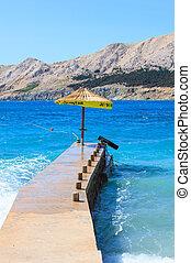 Umbrella in the Baska pier