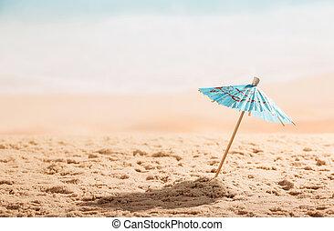 Umbrella in the sand close up on coast.