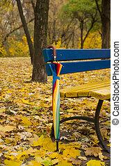 Umbrella near a bench in the autumn park