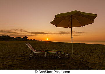 umbrella on the beach at sunset