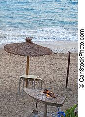 Umbrella on the beach in sunset