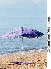 umbrella on the shore of the beach