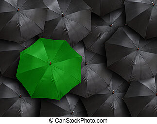 umbrella - concept for leadership with many blacks and green...