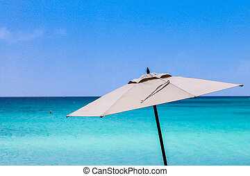 Umbrella with blue sky and ocean