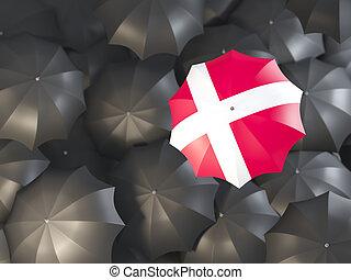 Umbrella with flag of denmark on top of black umbrellas. 3D...