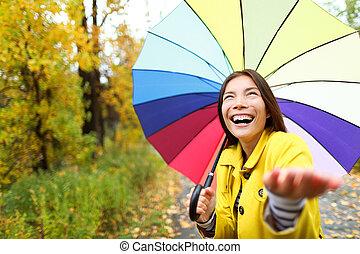 Umbrella woman in Autumn excited under rain