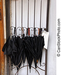 Umbrellas at the door of a yeshiva in the old town