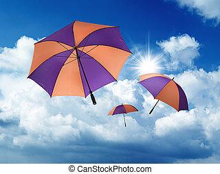 umbrella's, caer, de, un, cielo azul, con, blanco, cúmulos