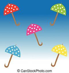 Umbrellas on blue background
