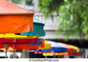 Colorful umbrella canopies at a riverside cafe in Texas