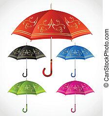 Umbrellas ornamental set. Vector