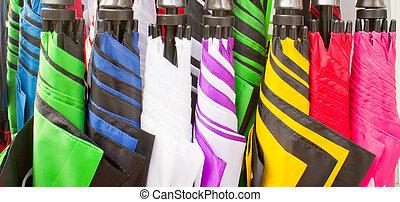 Umbrellas - Selection of colorful umbrellas in a store