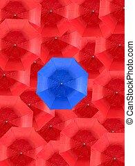 Umbrellas - A blue umbrella isolated against red umbrellas