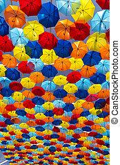 Umbrellas - Lots of umbrellas coloring the sky in the city...