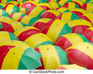 Umbrellas with flag of guinea