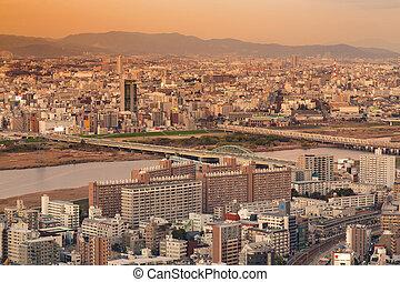 Umeda residence city skyline with mountain background, Osaka