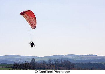 un, accionado, paraglider, piloto, en vuelo, encima, el, paisaje