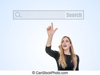un, atractivo, mujer, puntos, el, dedo, en, el, blanco, línea, de, un, virtual, búsqueda, internet, browser.