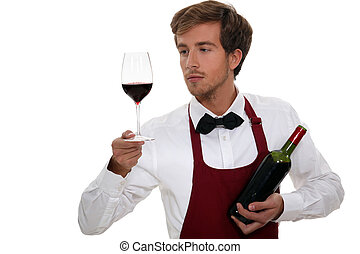 un, camarero de vino, mirar, un, vino rojo, vidrio