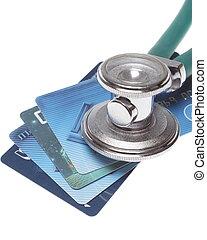 un, estetoscopio, por, un, tarjetas de crédito, pago