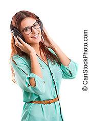 un, feliz, mujer joven, escuchar música