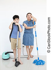 Un Happy asian family cleans the room.