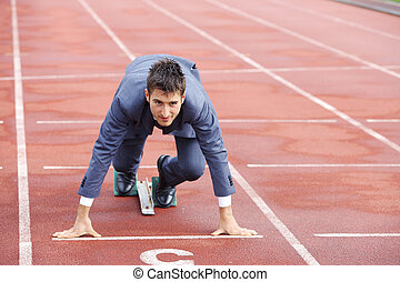 un, hombre de negocios, en, un, pista, listo, para correr