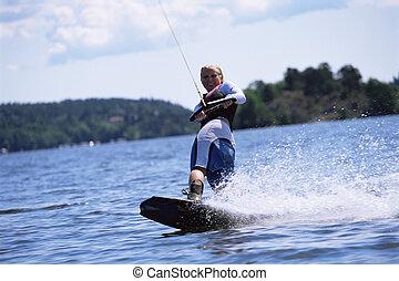 un, mujer joven, esquí acuático