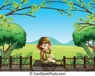 un, niña, sentado, en, el, puente de madera