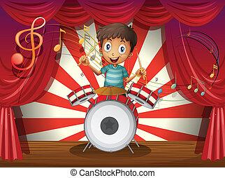 un, niño, en, el, centro, de, el, etapa, con, un, tambor