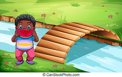 un, niño, sandías comestibles, cerca, el, puente de madera