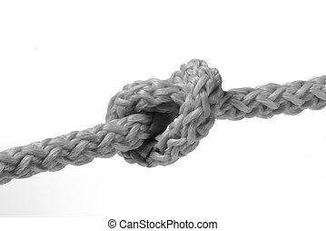 Un n?ud sur une corde sur un fond blanc neutre.