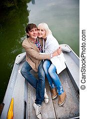 un, par, de, amantes, en un bote, en el parque