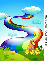 un, pato, y, ella, patitos, en, el, cumbre, con, un, arco irirs, sobre