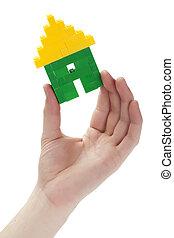un, tenencia de la mano, un, casa, lego