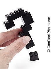 un, tenencia de la mano, un, lego, con, signo de interrogación, estructura