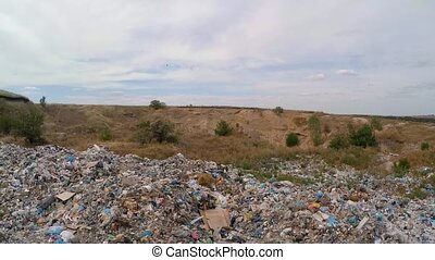 unauthorized dump in a quarry near a road. bird's-eye view....